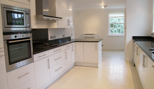 modern white kitchen with granite worktop