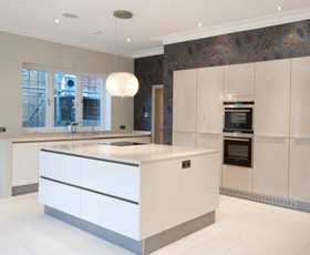 large spacious kitchen with tall units and centre island