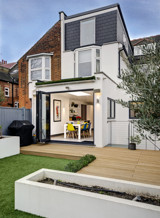 Terraced house decking and kitchen from the garden